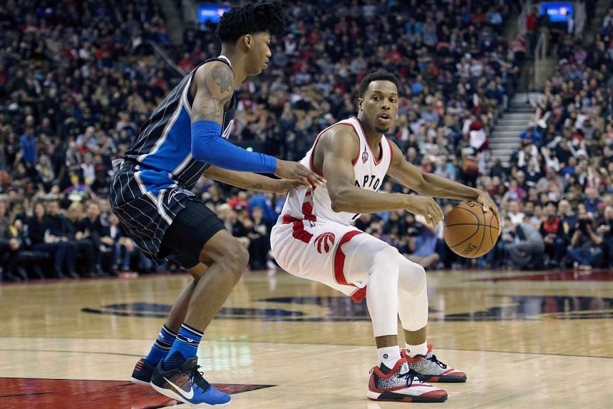 Toronto Raptors guard Kyle Lowry (right) goes up against Orlando Magic guard Elfrid Payton during their match at Air Canada Centre.