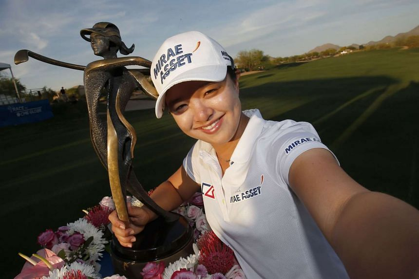 Sei Young Kim of South Korea poses for a selfie with the trophy after winning the LPGA JTBC Founders Cup on March 20, 2016 in Phoenix, Arizona.