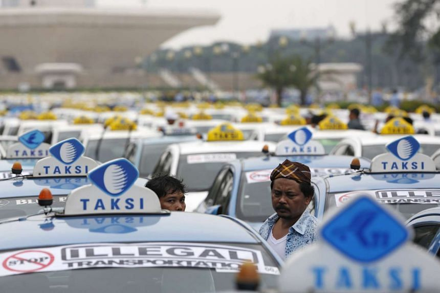 Taxis parked in protest against what they say is unfair competition from ride-hailing services, in Jakarta on March 21, 2016.