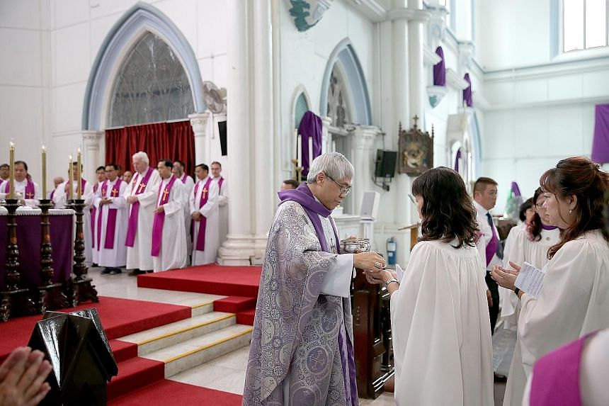 Archbishop William Goh celebrating mass at St Joseph's Church in Victoria Street. The Catholic Church said traditional religions have been slow to engage young people and help them appreciate their faith.