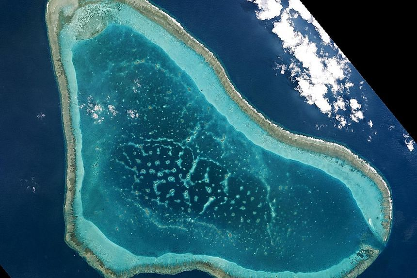 Boats at Scarborough Shoal, which is caught in the South China Sea dispute, are shown in this handout photo provided by Planet Labs, and captured on March 12.
