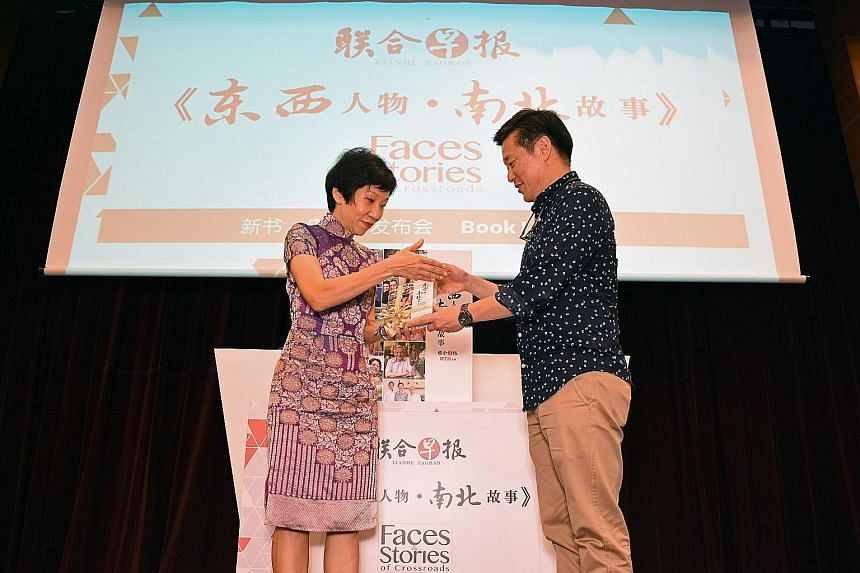 "Mr Goh presenting a copy of Faces & Stories of Crossroads to Ms Fu at the launch. The minister said the series offers glimpses of how immigrants have ""...successfully integrated in Singapore""."