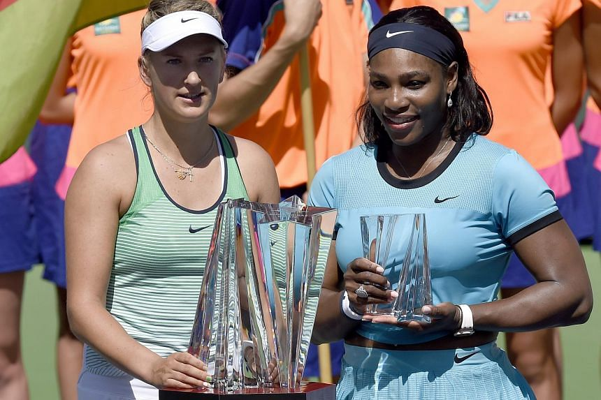Victoria Azarenka (left) and Serena Williams pose with their trophies following their final match at the BNP Paribas Open tennis tournament in Indian Wells.