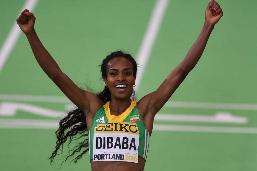 Gold medallist Ethiopia's Genzebe Dibaba celebrates after the 3000m final at the IAAF World Indoor athletic championships, on March 20, 2016.