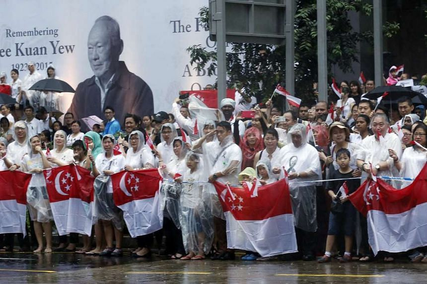 Singaporeans, some holding the national flag, lined the streets during the late Mr Lee Kuan Yew's state funeral procession on March 29, 2015.