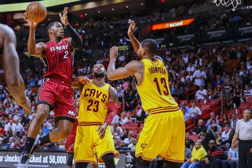 Miami Heat forward Joe Johnson (left) drives against Cleveland Cavaliers forward LeBron James (centre) and centre Tristan Thompson (right) of Canada on Saturday (March 19).