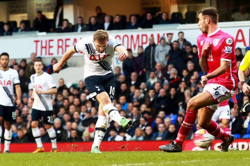 Tottenham's Harry Kane (centre) in action against Bournemouth's Steve Cook (right) during the English Premier League soccer in London on Sunday (March 20).