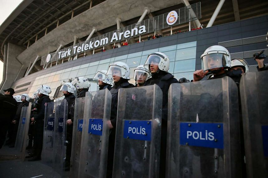 Turkish riot police secure the Turk Telekom Arena after the Istanbul soccer derby between Galatasaray and Fenerbahce was cancelled over security concerns in Istanbul on Sunday.
