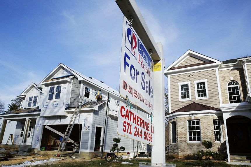 New homes under construction and for sale in Vienna, Virginia, on March 27, 2014.