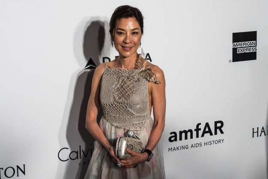 Hollywood actors including Uma Thurman and Adrien Brody rubbed shoulders with Asian stars such as Michelle Yeoh (above) and Rosamund Kwan at the amfAR Aids research fund-raising gala in Hong Kong last Saturday. At the event held at the Shaw Studios,