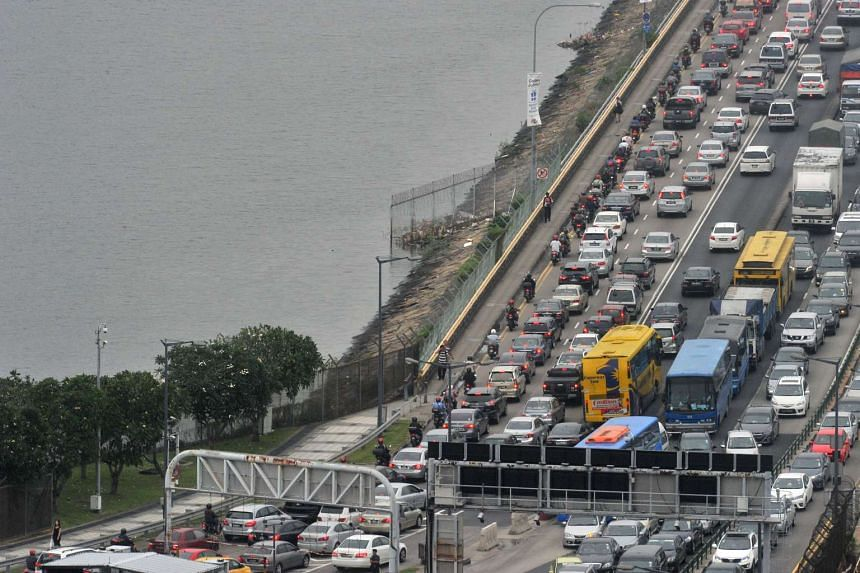 Long lines of vehicles seen on the Causeway on the evening of Dec 18, 2015.