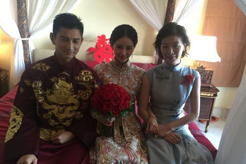 The couple with the bride's mother.