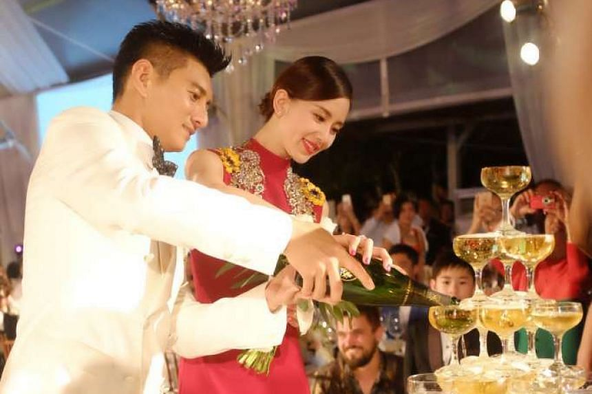 Nicky Wu and Liu Shishi at their wedding banquet on March 20, 2016.