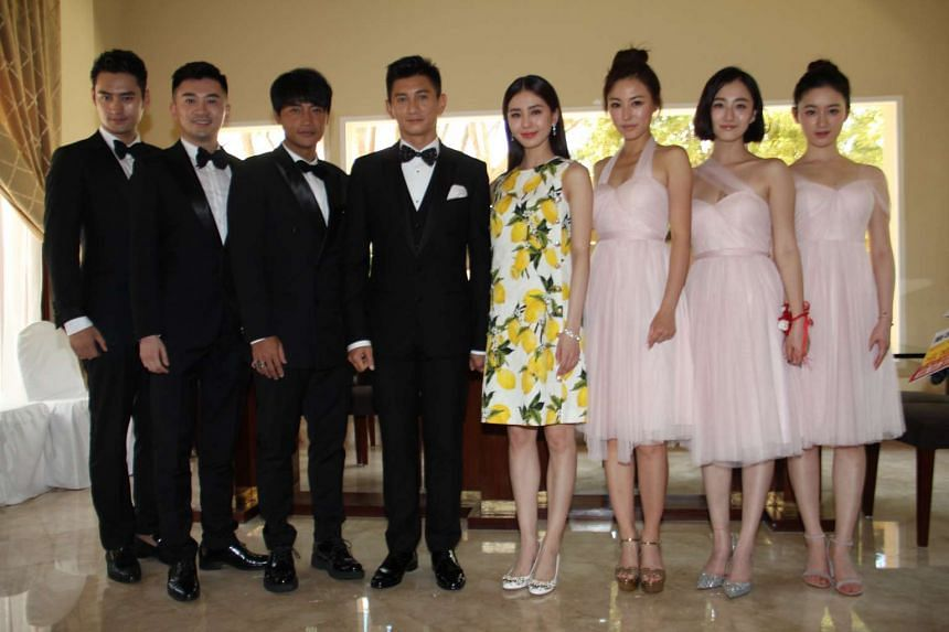 The couple (centre) with the entourage, from left: Yuan Hong, Alec Su, Julian Chen, Annie Liu, Julia Ye and Cristy Guo.