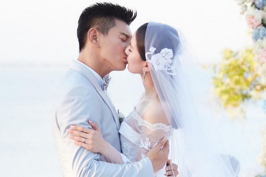 Nicky Wu (left) and Liu Shishi share a kiss during their wedding ceremony at Ayana Resort and Spa in Bali.