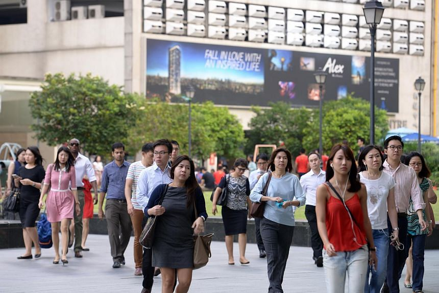 Office workers at Raffles Place, on Feb 18, 2015.