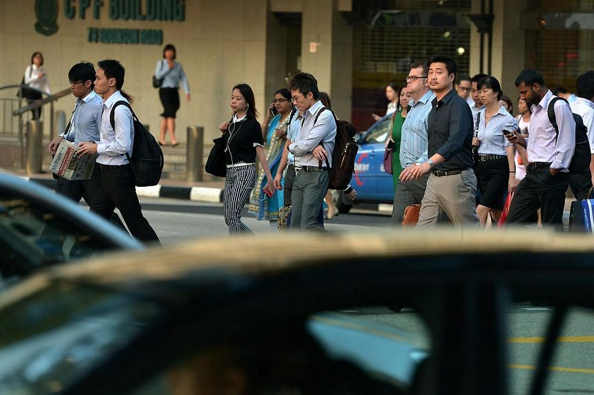 Office workers in the Central Business District of Singapore.