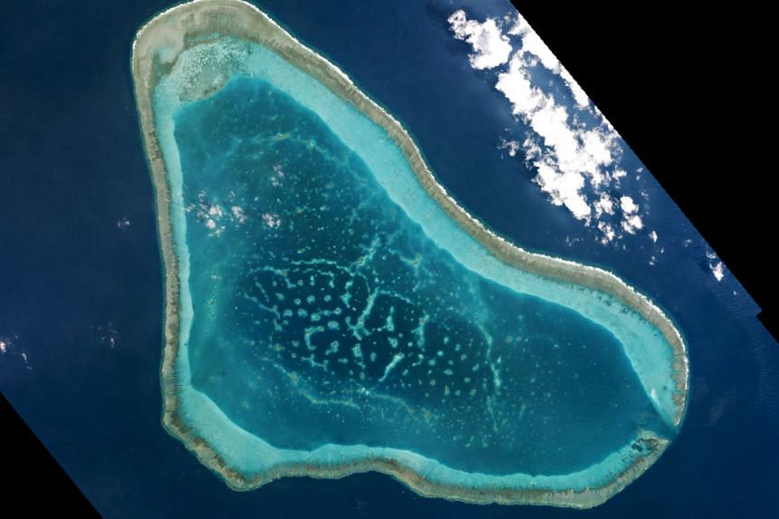 Boats at Scarborough Shoal in the South China Sea are seen in this handout photo by Planet Labs. The head of US naval operations, Admiral John Richardson, said the US military had seen Chinese activity around the shoal.