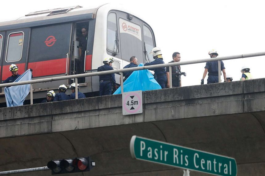 Civil Defence officers on the MRT track after an accident occurred near Pasir Ris MRT station on March 22, 2016.