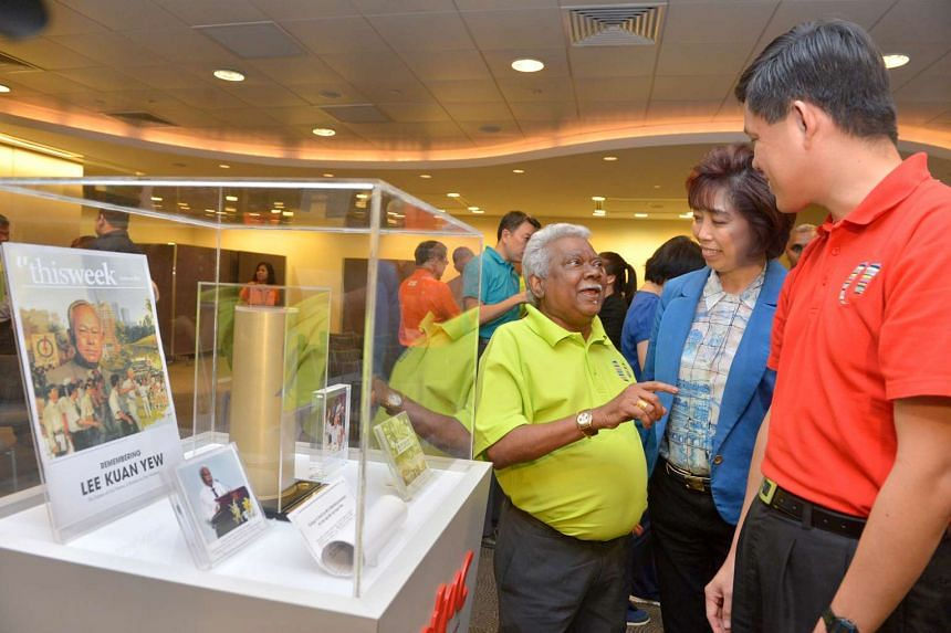 Mr G Muthukumarasamy (left) speaking to Mr Chan Chun Sing (centre) and NTUC president Mary Liew at the remembrance ceremony on March 22, 2016.