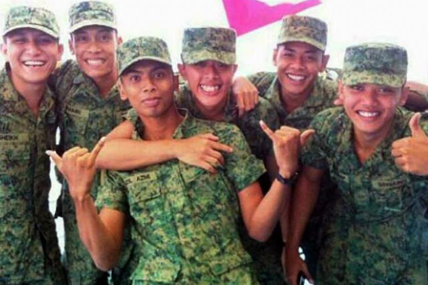 Asyraf Ahmad pictured with his friends in army.