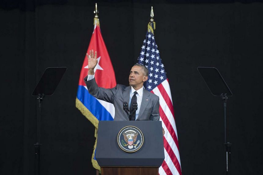Barack Obama waves after arriving to address the people of Cuba at the El Gran Teatro de Havana, in Havana, Cuba, on March 22, 2016.