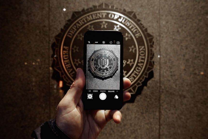 The official seal of the Federal Bureau of Investigation seen on an iPhone's camera screen outside the J. Edgar Hoover headquarters on Feb 23, 2016.