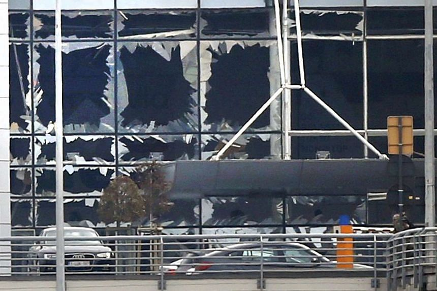 Broken windows seen at the scene of explosions at Zaventem airport near Brussels, Belgium on March 22, 2016.