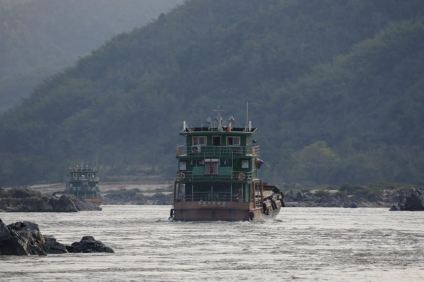 Chinese cargo ships sailing on the Mekong river on March 1.