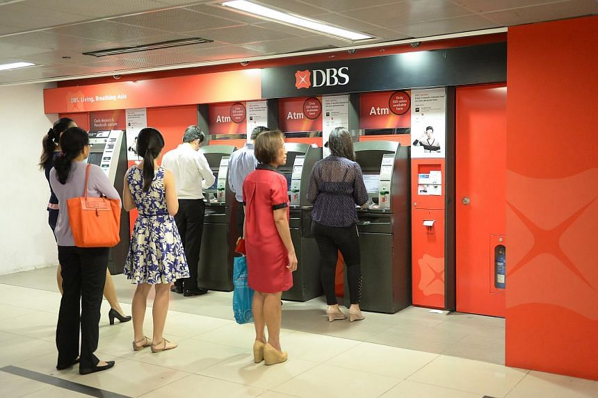 People queuing at a DBS ATM at Raffles Place MRT.