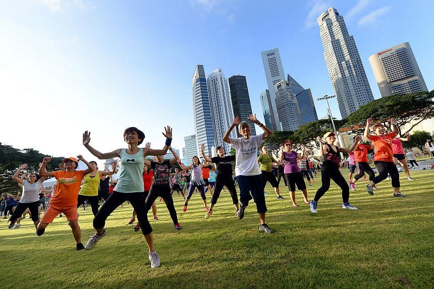 Fitness classes being conducted during  the first car-free Sunday on Feb 28, 2016. A health management seminar to be held next month will offer the public  tips on leading a healthy lifestyle.