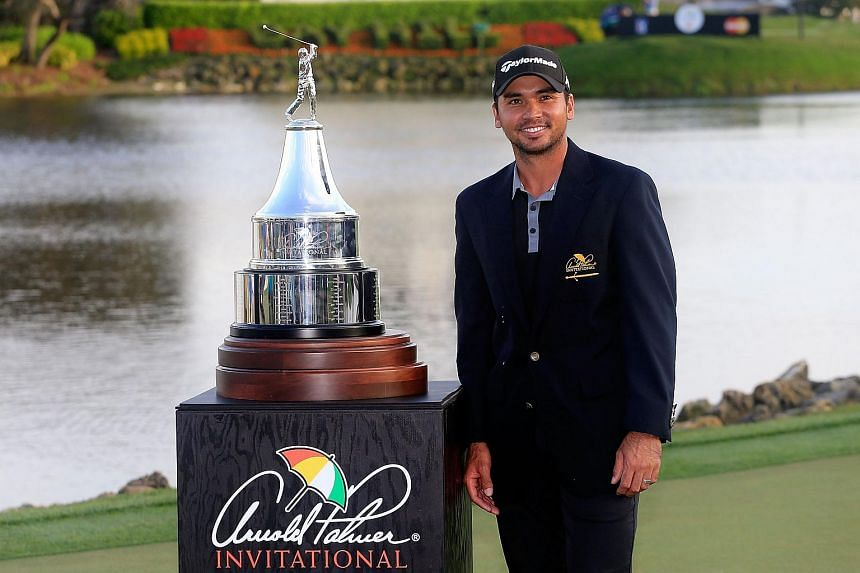 Jason Day poses with the trophy following the final round of the Arnold Palmer Invitational.