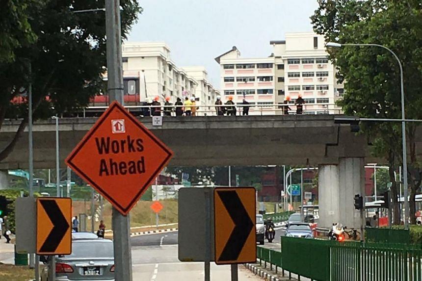 SCDF officers seen on the tracks near Pasir Ris MRT.