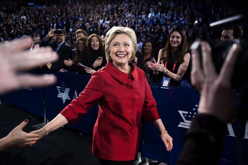 Democratic presidential candidate Hillary Clinton shakes hands prior to speaking at the American Israel Political Action Committee Policy Conference in Washington DC on Monday.