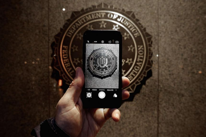 The official seal of the Federal Bureau of Investigation is seen on an iPhone's camera screen outside the J. Edgar Hoover headquarters, on Feb 23, 2016.