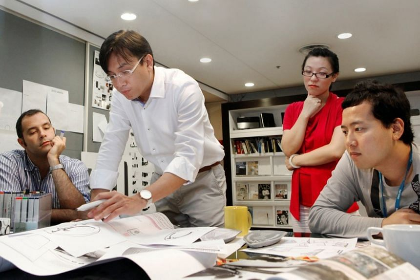 Philips' Mr Low (centre) holds design workshops to seek input from clients, and considers the environment in which its products will be used.