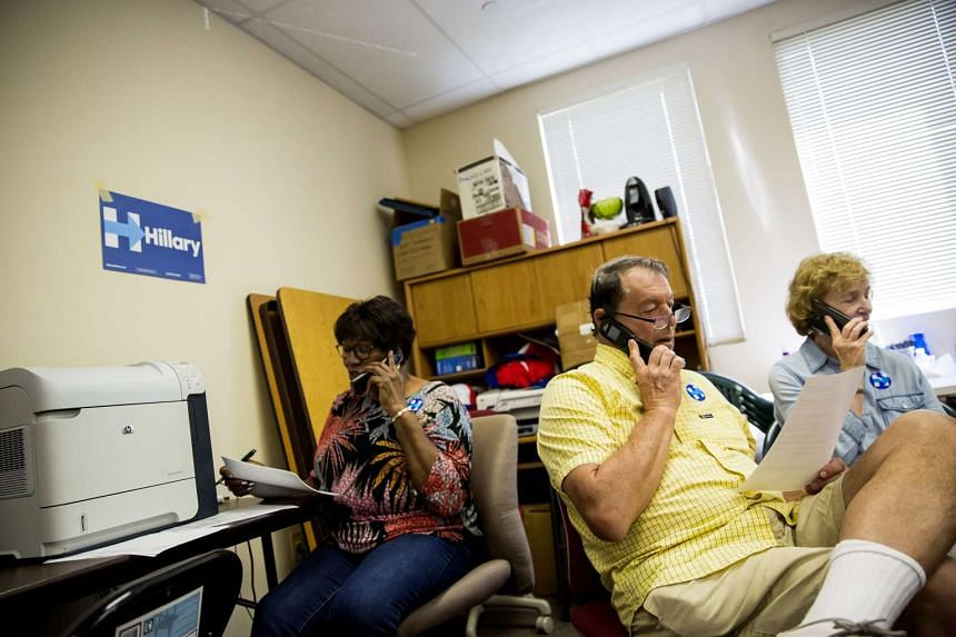 Volunteers operating a phone bank for American presidential candidate Hillary Clinton in Lake Worth, on the day of the Florida primary, March 15. Mrs Clinton owes much of her victory in Florida and other states to the strong support of voters aged 65