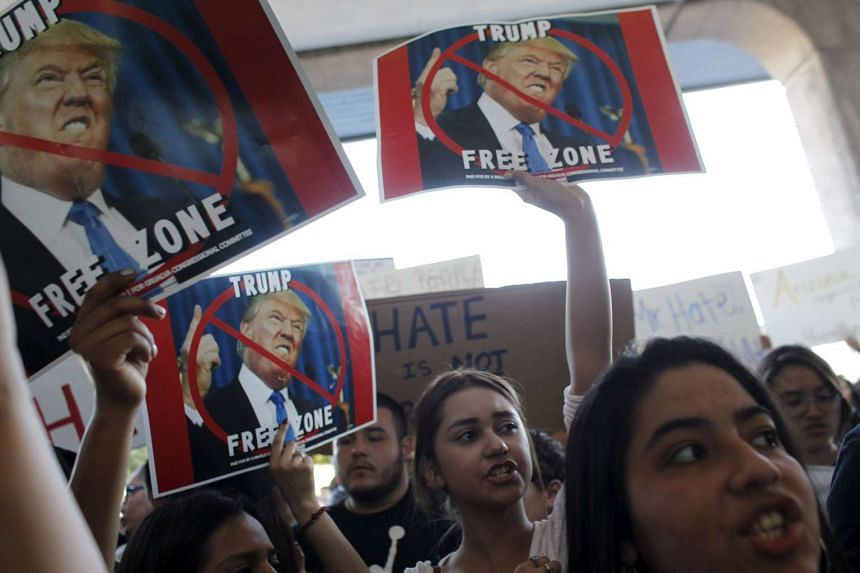 Demonstrators protesting during a Trump rally in Tucson, Arizona, last Saturday. Scenes of mayhem are common at Mr Trump's rallies, with the billionaire sometimes encouraging supporters who use violence against protesters.
