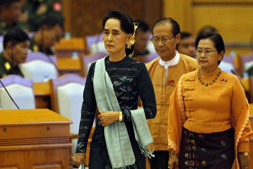 Ms Aung San Suu Kyi arrives at a union parliament session in Naypyitaw, Myanmar, on March 15, 2016.