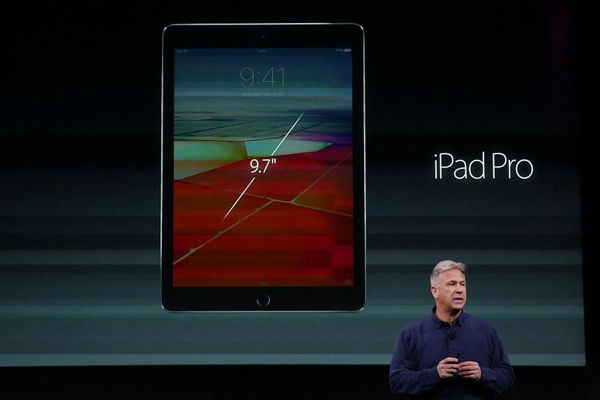 Mr Phil Schiller, Apple vice-president of worldwide marketing, introduces the 9.7-inch iPad Pro at the Apple Campus Town Hall in California.