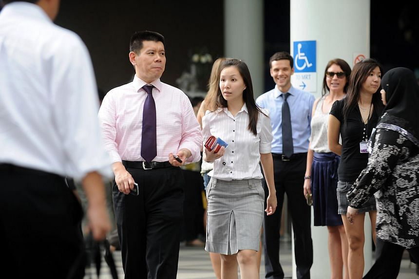 Office workers at Raffles Place during the lunch hour.