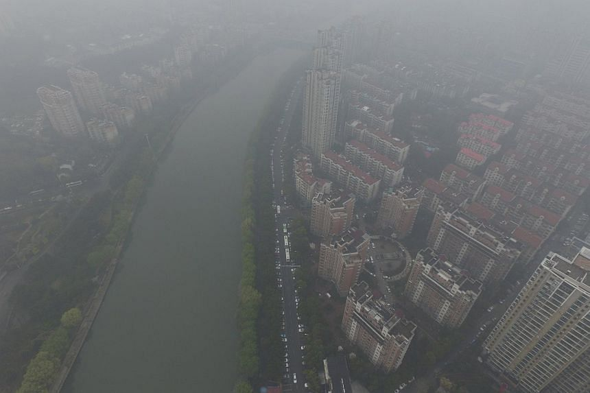 Residential buildings in smog during a polluted day in Nanjing on March 19, 2016.