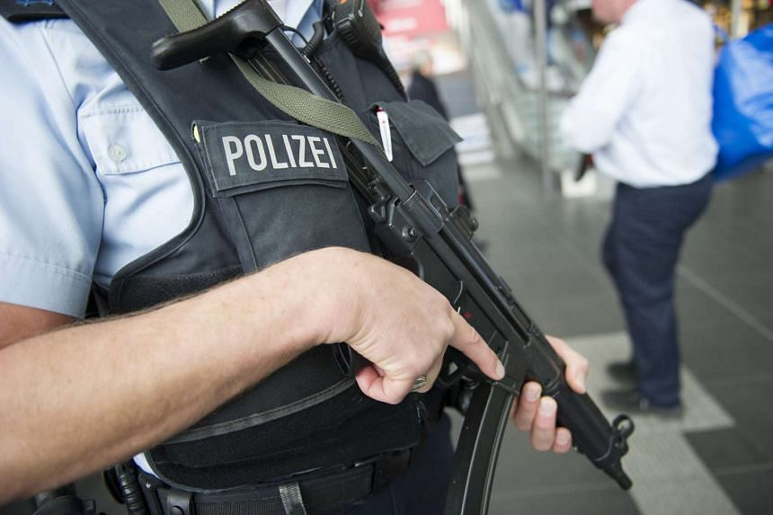 An armed German police officer in the main railway station in Berlin, Germany, on March 22, 2016. Likewise, Argentina has said that it will step up security in preparation for US president Barack Obama's visit.