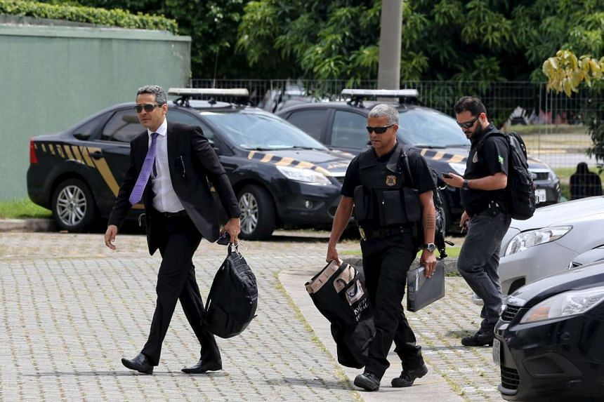 Brazilian federal police officers arrive with bags to their headquarter after their investigation of Latin America's largest engineering firm Odebrecht SA, in Sao Paulo.
