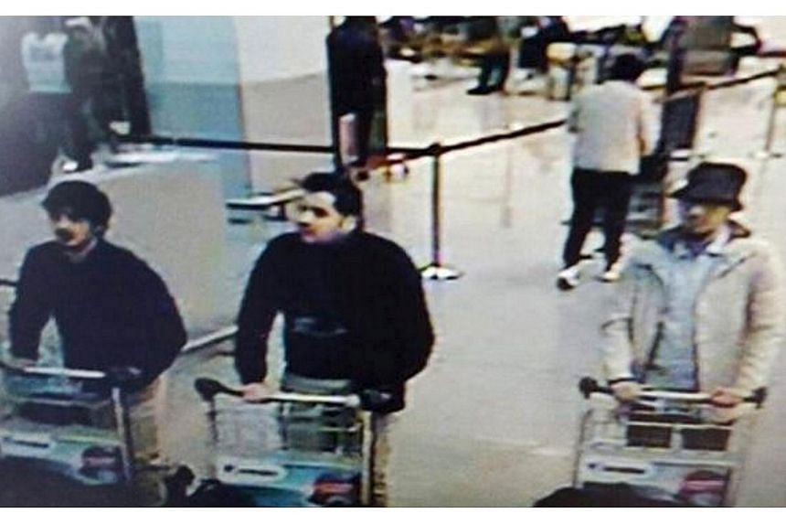 An image from CCTV footage showing three suspects Belgian police believe to be behind the bombing at Brussels airport on March 22, 2016.