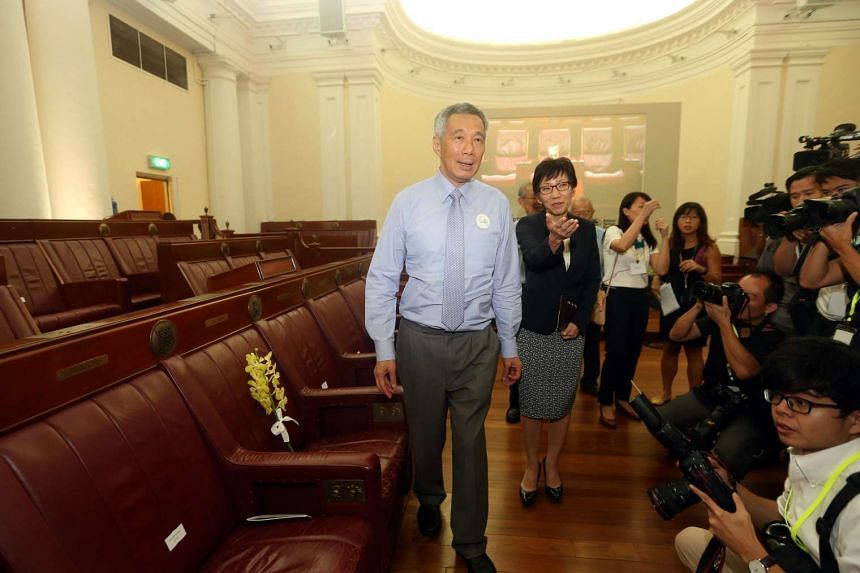 Prime Minister Lee Hsien Loong and Ms Grace Fu, Minister for Culture, Community and Youth, walks past the seat of the late Mr Lee Kuan Yew on March 23, 2016.