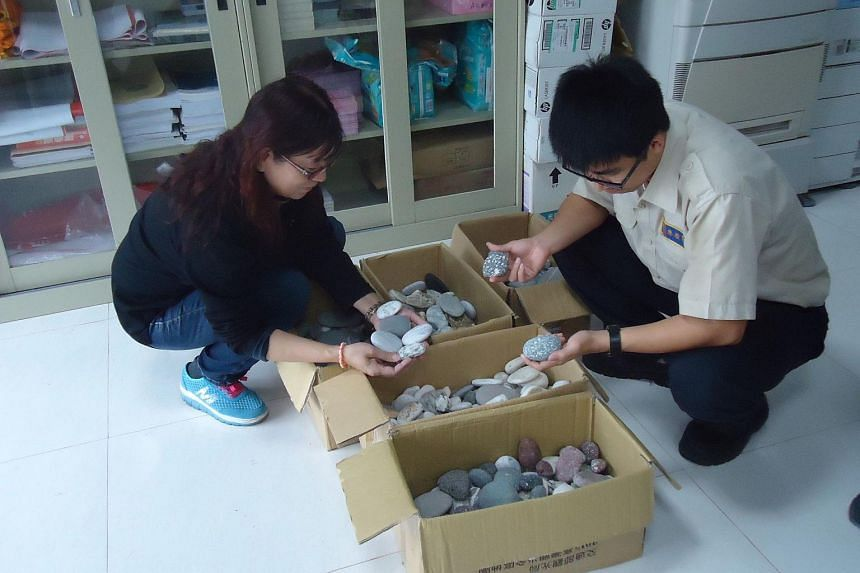 Taiwan's East Coast National Scenic Area Administration office shows beach pebbles seized from tourists at the administration's office in Taitung.