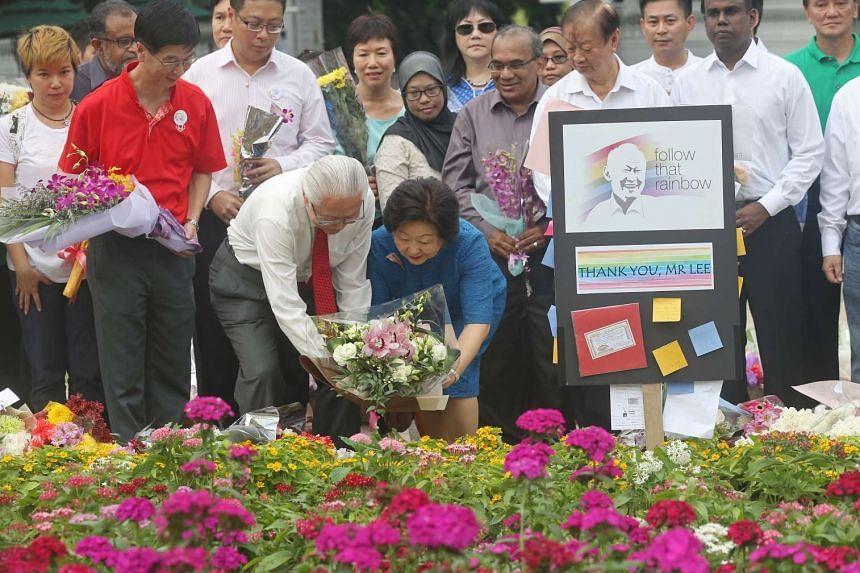 President Tony Tan and his wife Mary laying a bouquet at Istana Park.