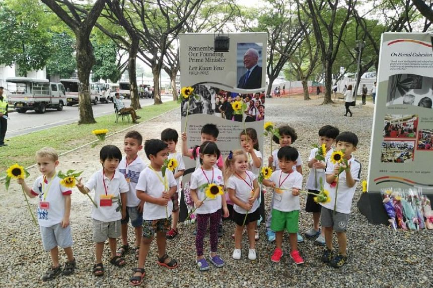 Preschool children about to lay flowers for Mr Lee Kuan Yew at a remembrance site.