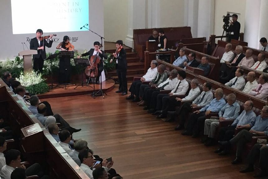 Past and present parliamentarians gathering at the old Parliament House to remember the late Mr Lee Kuan Yew.